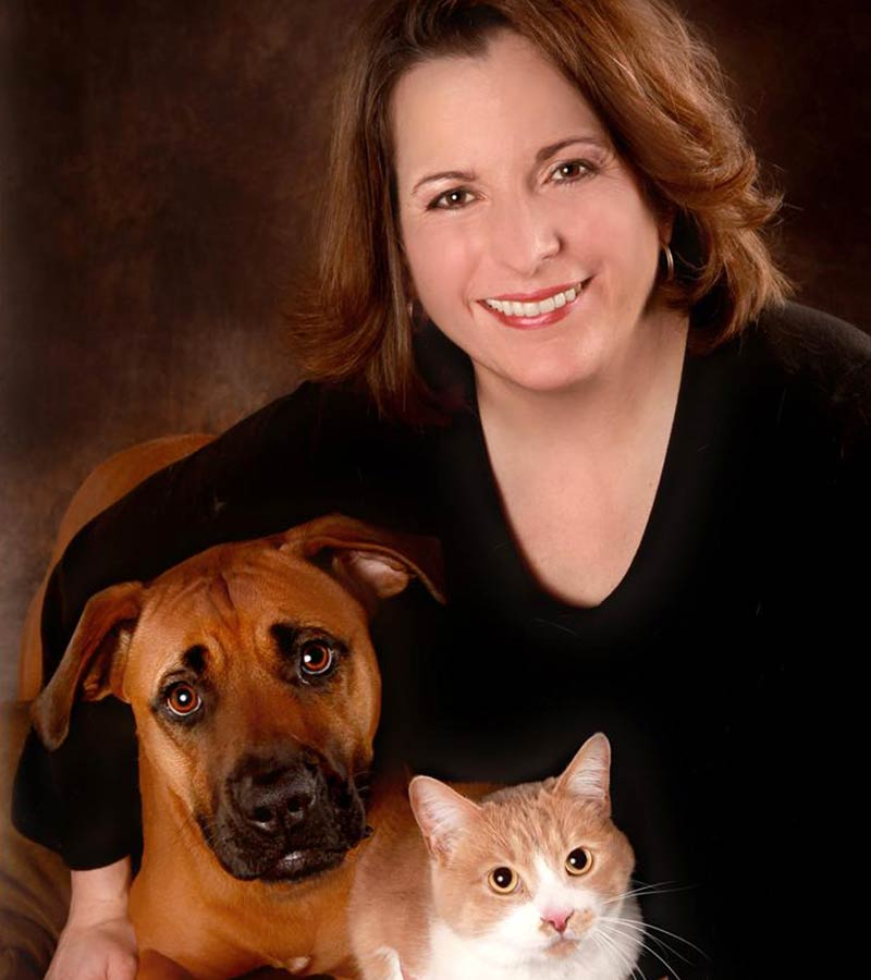 http://A%20female%20named%20Danielle%20is%20holding%20a%20dog%20and%20a%20cat
