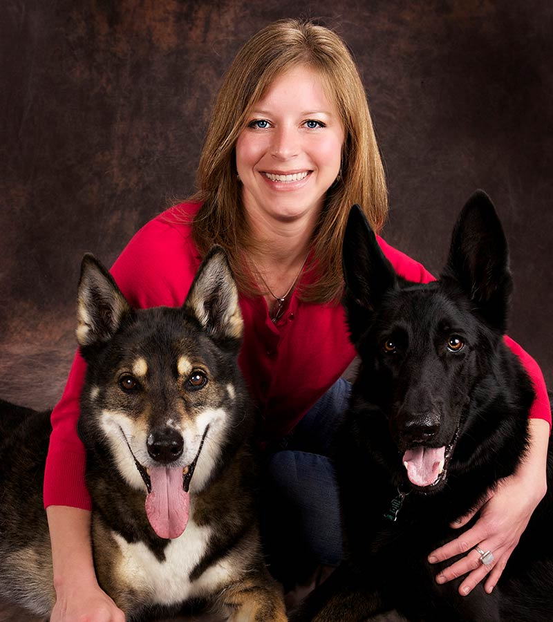 http://A%20female%20named%20Sarah%20is%20holding%20two%20big%20dogs