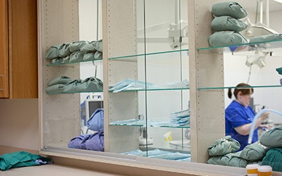 Shelves full of surgery packs for during and after pet surgeries