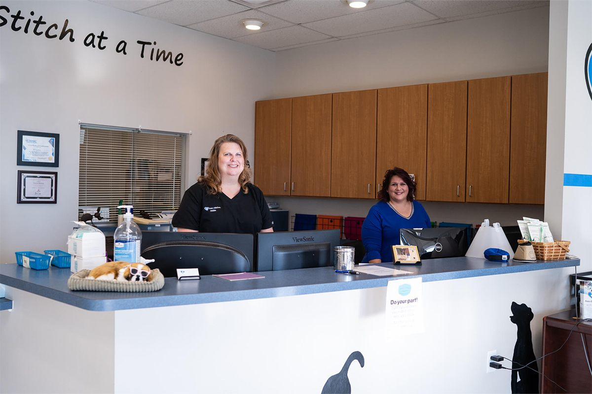 two ladies standing at front desk of vet office